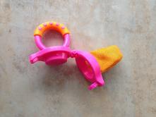 Krmící sítka na ovoce zn. munchkin růžová oranž 6+,