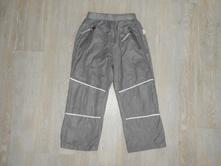Trend - šusťákové kalhoty, vel. 110, tulec trend,110