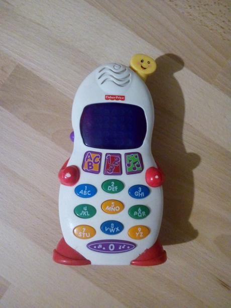 Fisher-price hrající telefon,