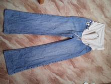 Těhotenské kalhoty, l