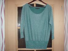 Lesklý svetr, 38