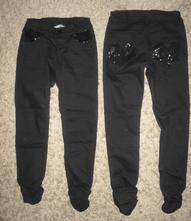 Černé kalhoty s flitry zn. lindex, 140