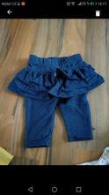 Kalhoty se sukní, 62