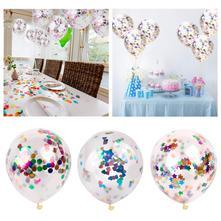 Balónek s barevnými konfetami,