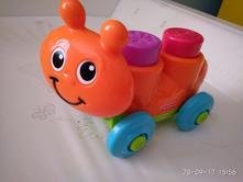 Jezdící oranžový šneček fisher price,