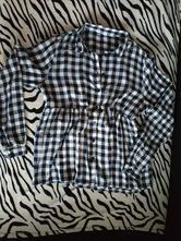 Těhotenská košile, l