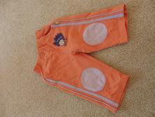 Oranžové tepláky, 74