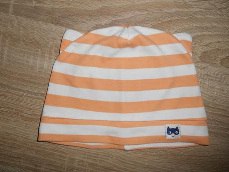 Bílo oranžová čepička, 74