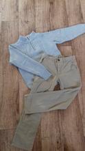 Kalhoty a svetr,